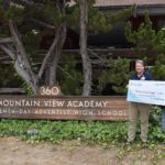 Solar cash out check to mountain view academy