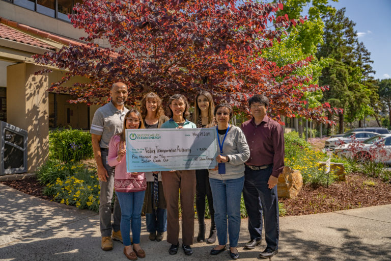 VTA staff holding giant check