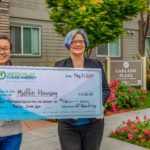 Sunnyvale Councilmember and MidPen Housing Rep Holding Giant Check