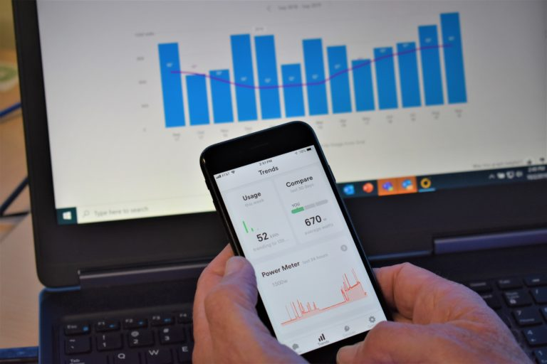 image of phone holding hand with data monitoring