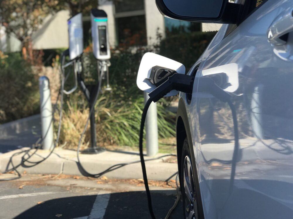 image of electric car plugged into charger